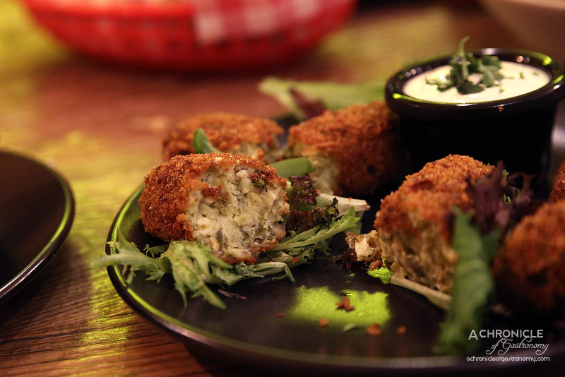 Village Cantina - Jalapeno poppers - Jalapenos, cheese, herbs, lemon zest, in bread crumbs ($9)