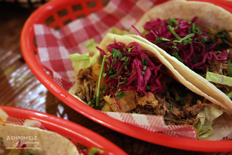 Village Cantina - Carnitas Taco - Pulled pork, grilled pineapple, red ...