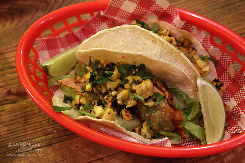 Village Cantina - Pollo Taco - Achiote chargrilled chicken, lettuce, grilled corn, and salsa verde ($7 for one, $12 for two)
