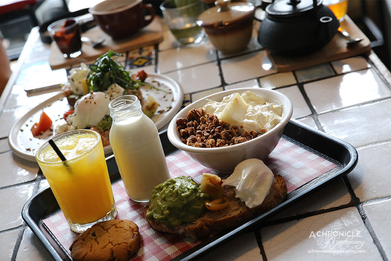 Fordham's Milk Bar - The Milkman's Tray with granola, avo smash on toast with poached egg, cookie and OJ ($18)