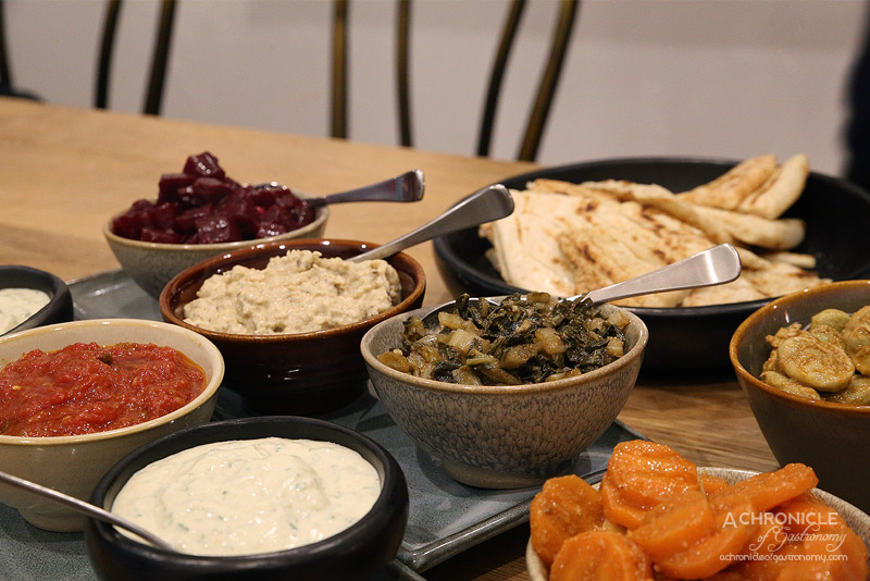 Mama Morocco - Matbucha (tomato, garlic, green chilli) Carrot (garlic, spices, lemon) Beetroot (spices, pepper, vinegar) Broad beans (lemon juice, Casablanca spices) Silverbeet w lemon, Baba ganoush, Tachina