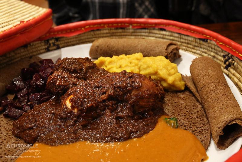 Saba's Ethiopian Restaurant - Dorho Sebhi - Chicken on the bone slow cooked over a few hours, served with hard-boiled egg