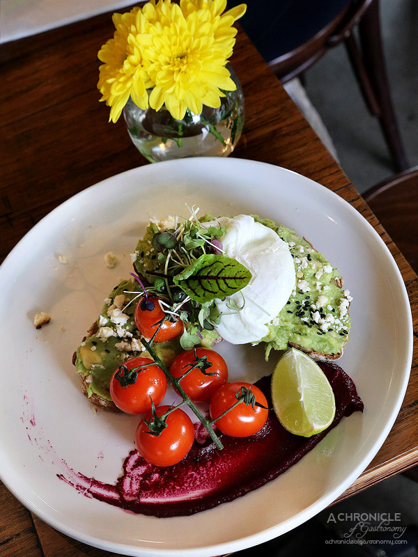 Son of a Pizzaiolo - Smashed Avocado - Infused with lemon juce, thyme, multigrain sourdough, baked ricotta, poached egg, beetroot puree, cherry tomatoes, black sesame seeds, fresh lime