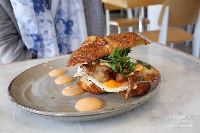 White MOJO Balwyn - White Mojo Croissant Burger - Croissant burger, soft shell crab, pickled cucumber, chipotle mayo, smoked eel, fried egg, chorizo dust ($24)