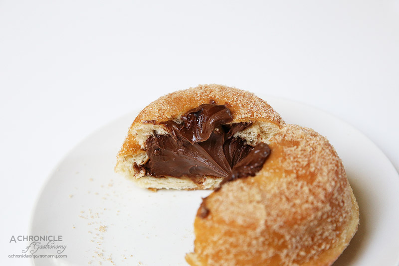 Doughnut Time - Love At First Bite - Signature Nutella-filled doughnut, dusted with cinnamon sugar
