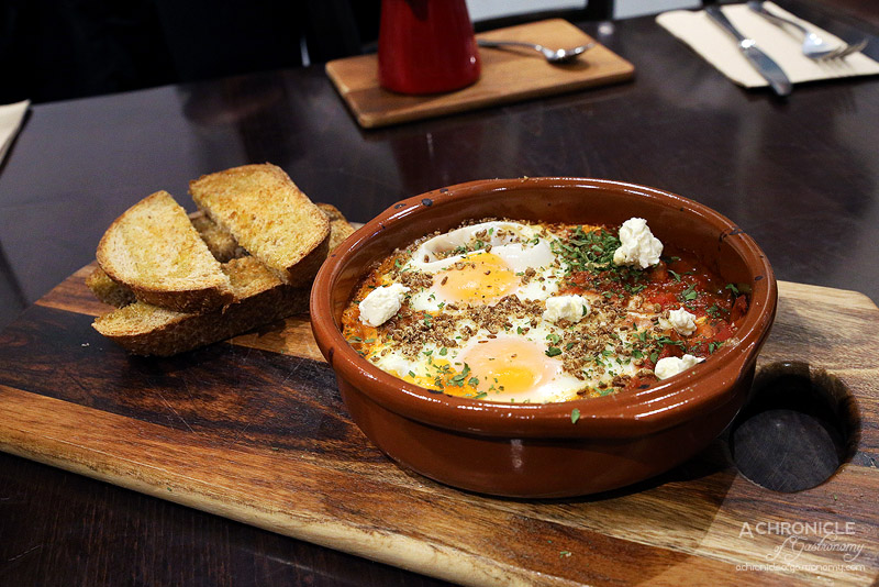 Foddies - Shakshuka-Dukkah - Eggs baked in a spiced-sauce of tomato, capsicum, potato and spinach topped w house-made dukkah & labne, toast, garlic oil ($17)