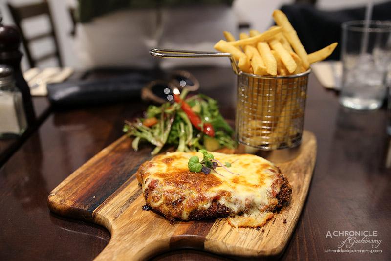 Foddies - Chicken Parmigiana - Chicken schnitzel w Foddies' Napoli sauce and mozzarella, chips, garden salad ($24)