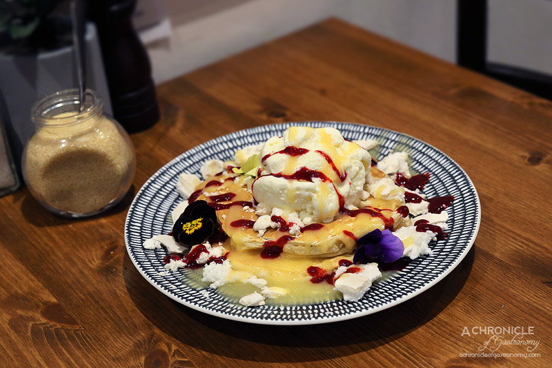 Foddies - Lemon Meringue Pancakes - Two stack, served w house-made lemon curd, crumbled meringue, raspberry coulis and ice cream, choice of batter wheat or gluten free ($17)