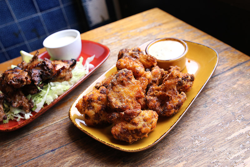 The Worker's Kitchen (25) Fried buffalo cauliflower with ranch dressing ($10)