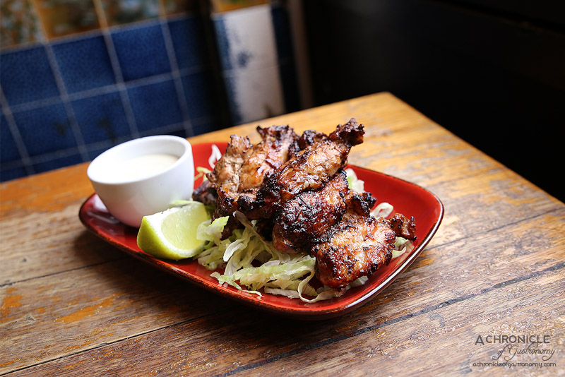 The Worker's Kitchen - Jerk spiced chicken ribs with coconut lime dipping sauce ($12)