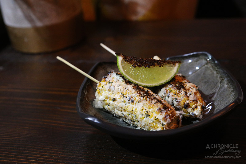 United Kitchen - Grilled Corn - Char-grilled whole corn, parmesan, ancho chilli, lime, & blue vein cheese ($4 ea)