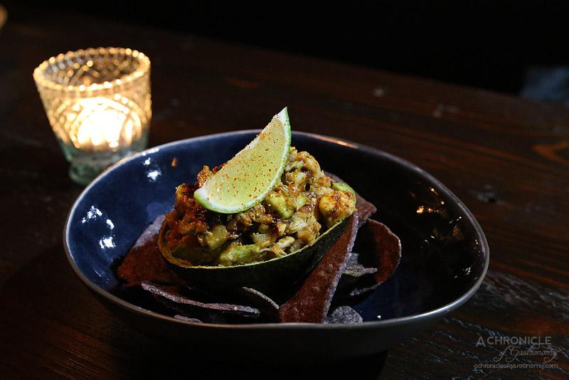 United Kitchen - Crab meat stuffed avocado - Avocado stuffed with Blue Swimmer crab, cherry tomato, onion, chilli & fresh lime ($16)