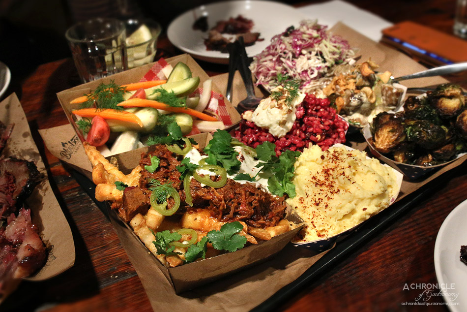 Bluebonnet Barbecue - Brisket chilli cheese fries w jalapeno & sour cream, Apple, kohlrabi & coriander slaw w sherry mustard vinaigrette, Miso fried brussel sprouts, Jalapeno cheese grits, McClure's pickles