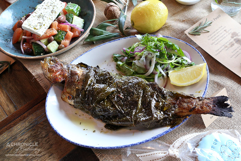 IONIO - Chargrilled rainbow trout wrapped in vine leaves, marinated in lemon & garlic