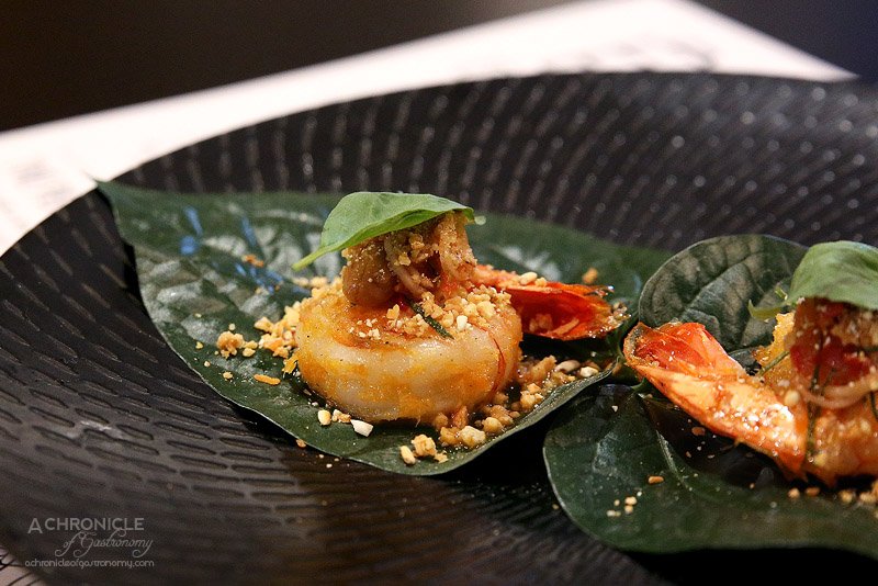 Pintoh - Betel Leaf Prawns - Grilled prawn betel leaf wrap topped with mild chilli-herb sauce ($4.50 pp)