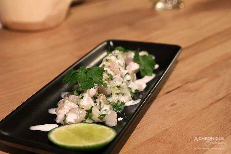 Saint Lucia - Kingfish ceviche cured in lime and coconut milk served w fresh cucumber + coriander ($18)