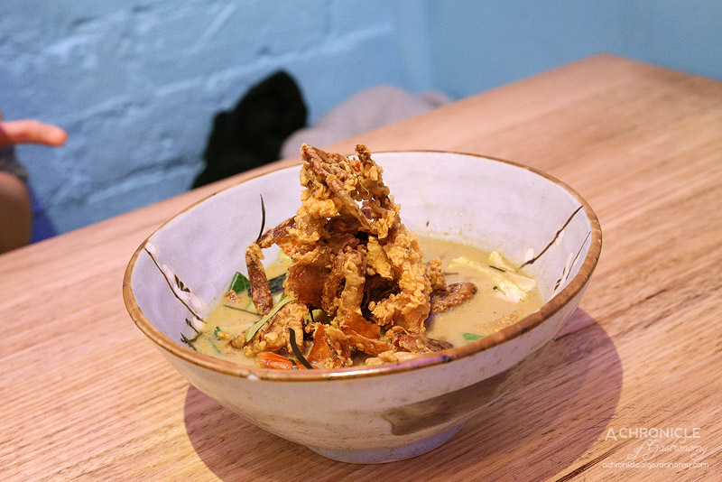 Son in Law - Crispy Soft Shell Crab & Tiger Prawns - Traditional Thai green curry, Thai basil, kaffir lime leaves ($16)