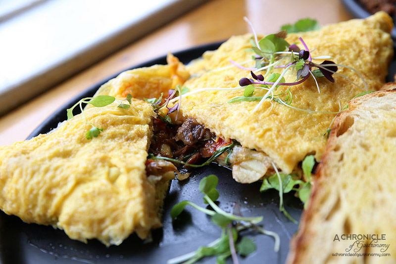 Uncle Drew - Omelette with sichuan pepper and cider braised pork hock, kipfler potatoes, manchego, coriander, sambal oelek and sourdough toast ($17)