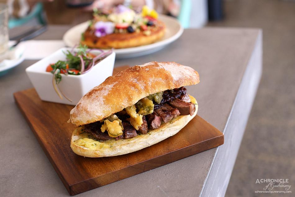 1809 - Hanger sandwich w wagyu steak, red onion jam, wasabi butter, horseradish and tempura beetroot leaves ($17)