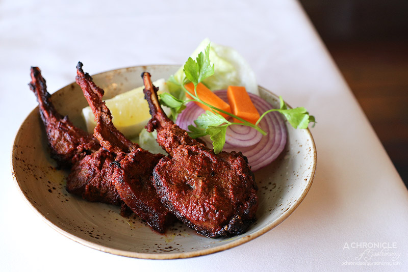 Bhoj - Hoshiarpuri Champaan - Hot lamb cutlets marinated in malt vinegar, cumin powder and medium spices, barbequed, finished with tangy sauce (3 for $16.50)