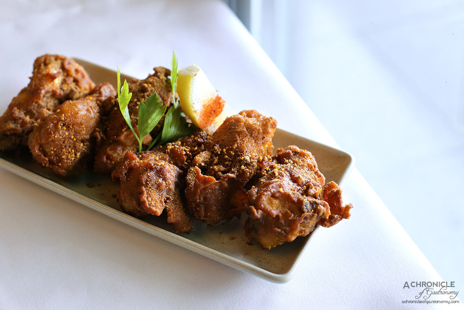 Bhoj - Gunpowder Chicken - Chicken winglets in fiery South Indian five spice gunpowder batter, deep fried ($12.50)