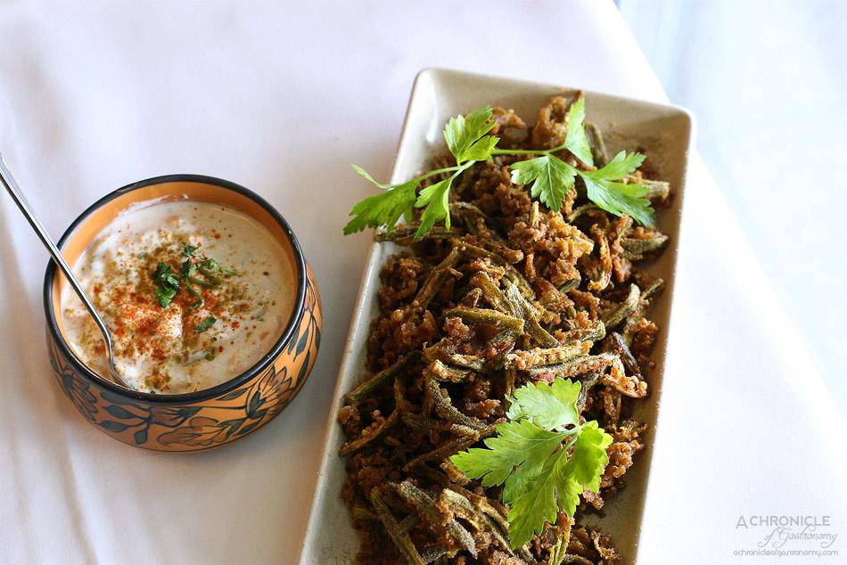 Bhoj - Okra Kurkure - Tempura style okra chips cooked in tangy dry mango batter ($16), Raita - Cucumber and tomato yoghurt ($4)