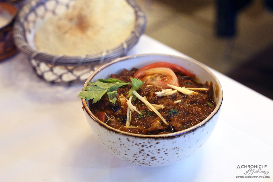 Bhoj - Kadai Baingan - Eggplant in crushed pepper, coriander seeds, herb and tomato based sauce ($14.50)