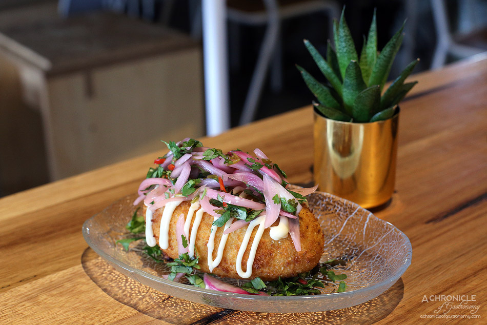 El Atino & Co - Peruvian Papa Rellena - Silky potato stuffed with beef served with salsa criolla ($12)