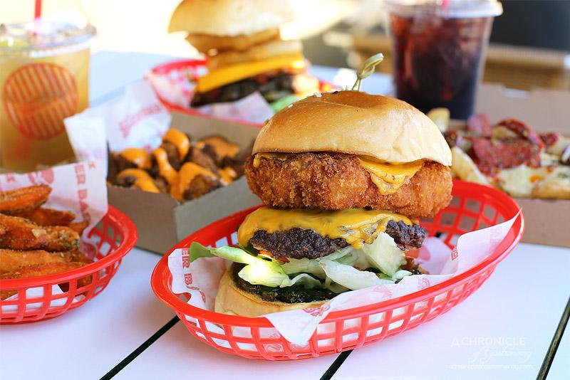Mocha Jo's Burger Bar - The Mac n Cheese - Panko crumbed mac n cheese pattie, wagyu, double US cheese, lettuce, mustard, pickles, tomato, jalapeno, brown onion jam