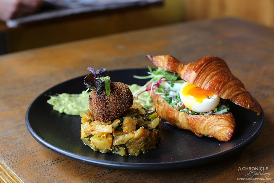 Pavlov's Duck - Lankan Frenchy - Organic croissant w chilli fried potatoes, Asian tabouli, fish & potato fritter & a soft boiled egg ($19)