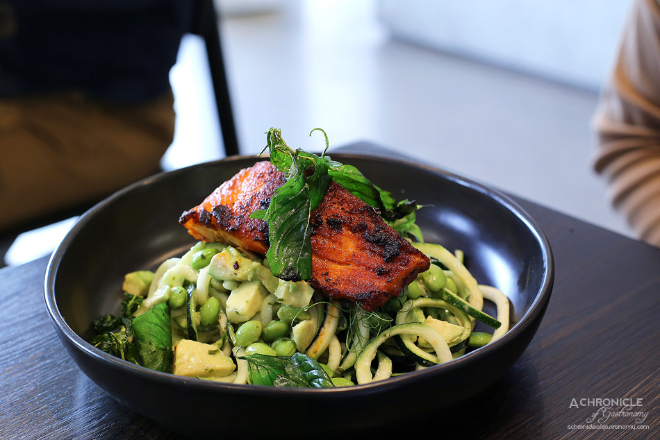 Penta - Sriracha Grilled Salmon w raw zoodles, edamame, avocado w herb dressing and fried basil ($21)