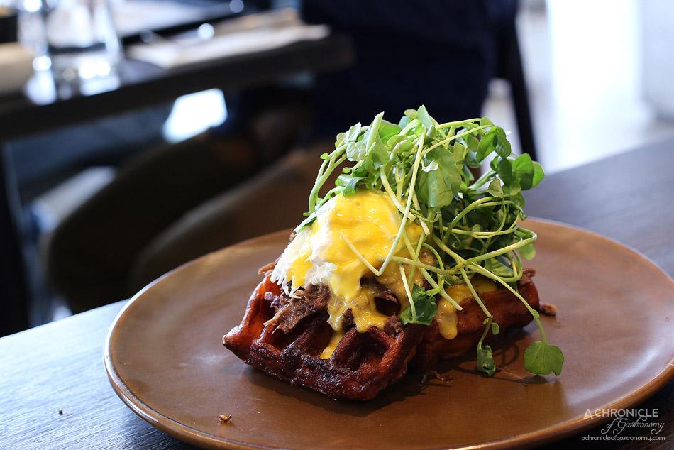 Penta - Penta Benedict - Braised beef cheek, watercress, poached eggs, jalapeno hollandaise, sweet potato waffles ($19.50)