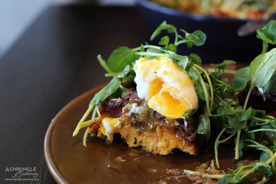 Penta - Penta Benedict - Braised beef cheek, watercress, poached eggs, jalapeno hollandaise, sweet potato waffles ($19.50)