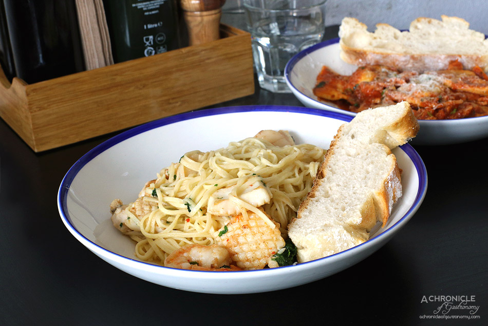 Sauced - Marinara Aglio Olio spaghetti w scallops, prawns, calamari and white fish ($25)