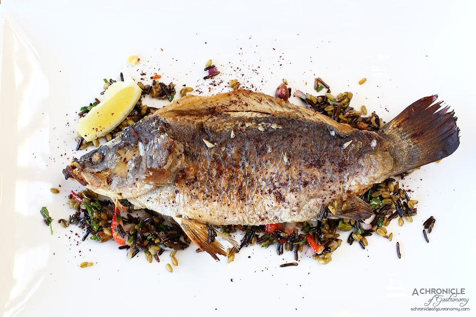 Senses - Whole de-boned barramundi w freekeh, wild rice, preserved lemon and strawberry salad