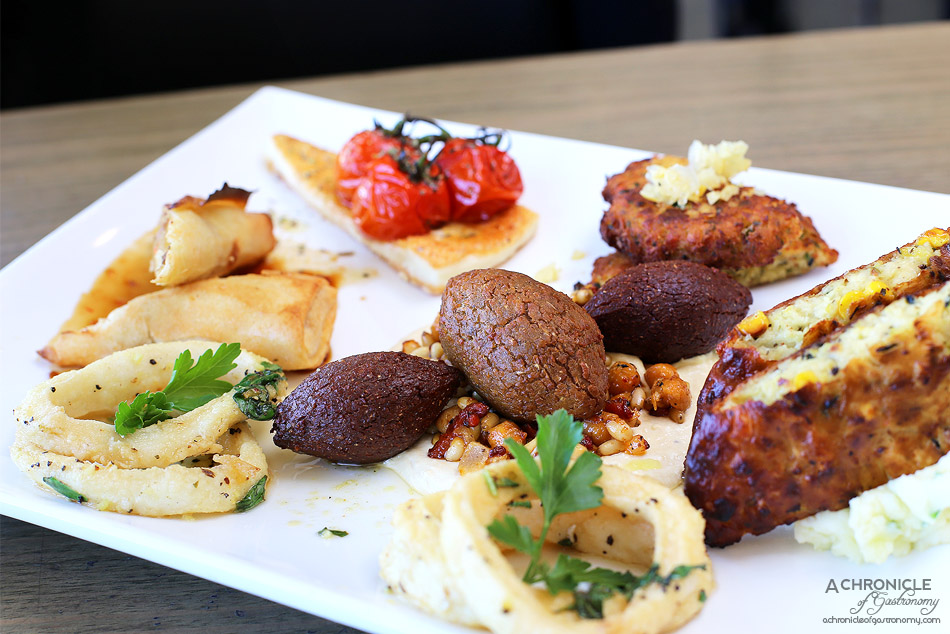 Senses - Saganaki, Lamb kibbi, Vegetarian kibbi on hummus chickpeas and pine nuts, Crab cakes, Duck spring roll, Zucchini and goat cheese fritters on a bed of skordalia, Calamari