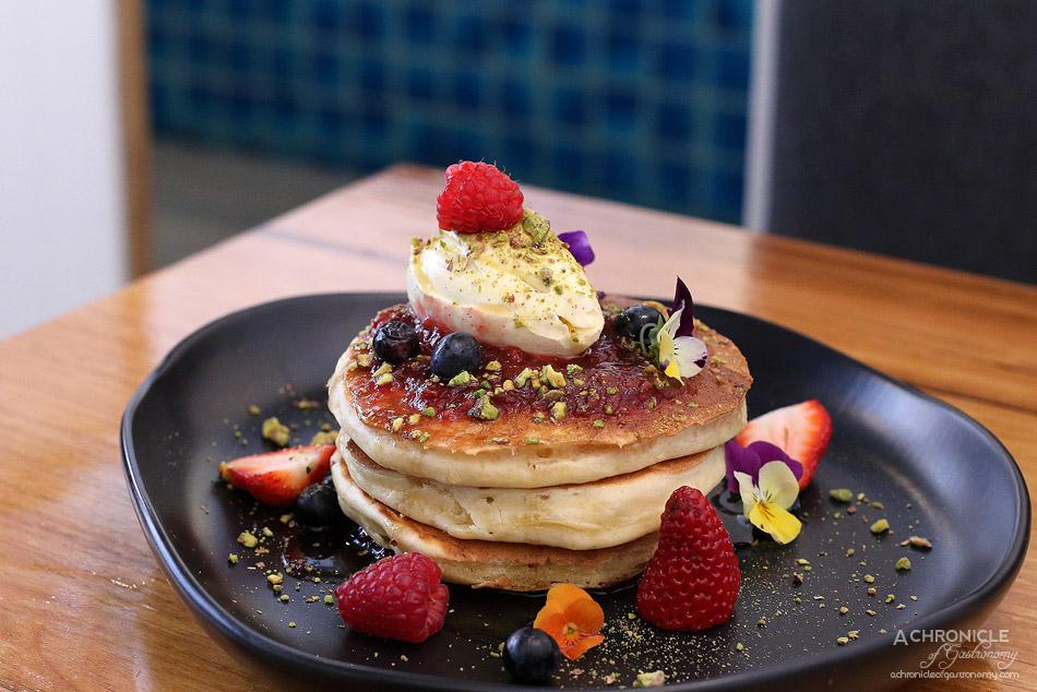Two Birds One Stone - Ricotta pancakes w berry compote, vanilla mascarpone, pistachios ($18)
