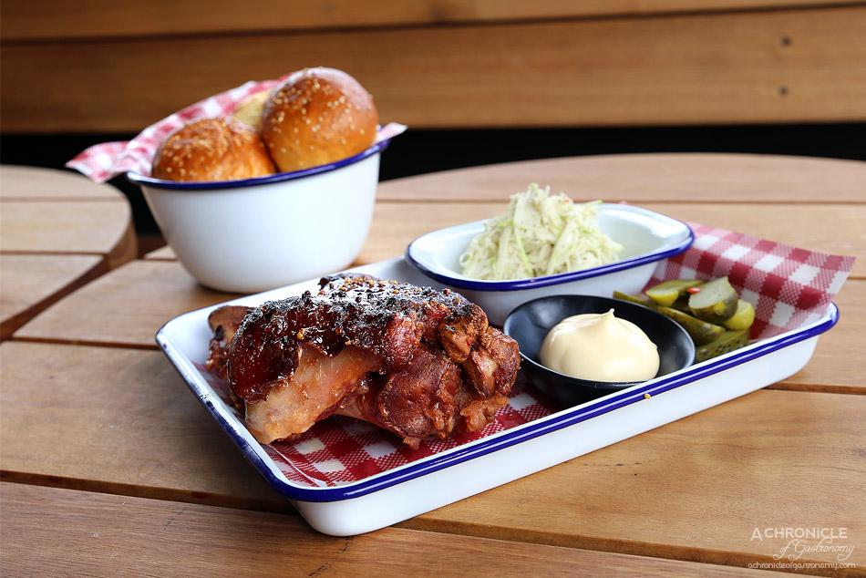 Corner Hotel - Whole smoked pork hock - apple & caraway slaw, pickles, mayo & mini milk buns ($45)