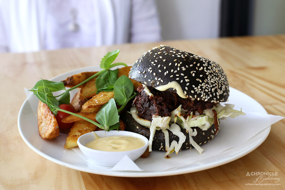 Junkyard - 12-hour slow cooked pulled lamb brioche burger w spicy slaw, aioli, potato wedges ($18.50)