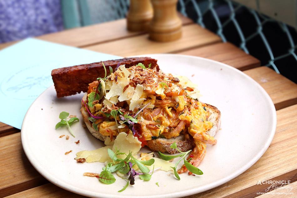 Tinker - Chilli scrambled eggs w coriander, bacon, cherry tomatoes, Vietnamese mint, fried shallots, parmesan on sourdough + rosti ($19.50 + 3.50)