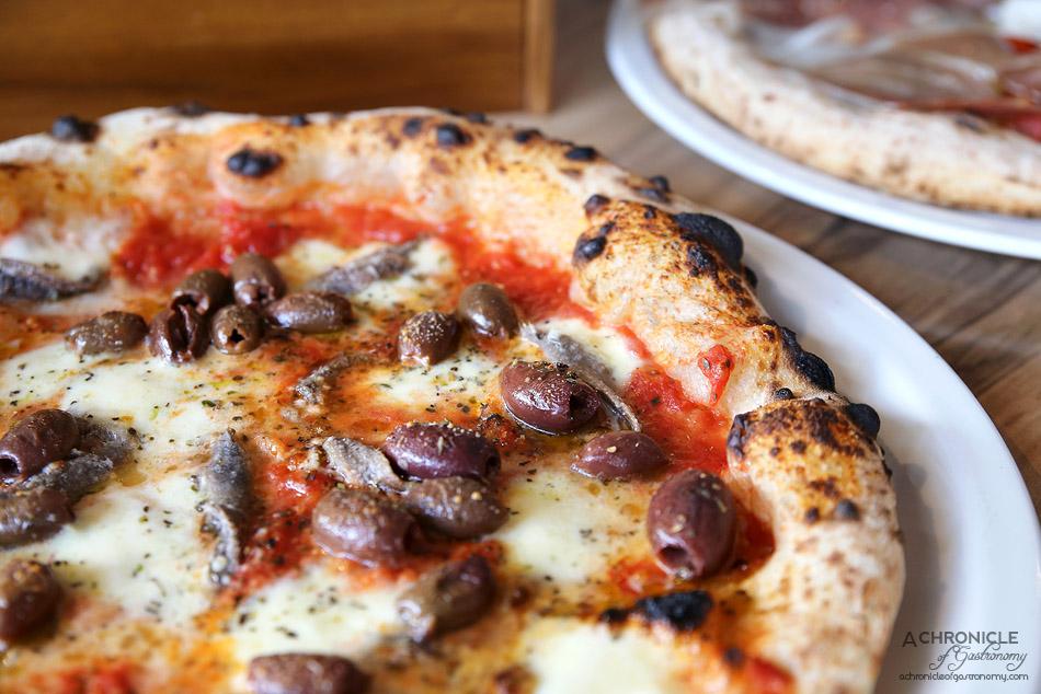 Pizzaiolo Micheluccio - Napoletana-Romana - S Marzano Tomato, Fior Di Latte Mozzarella, Anchovies, Olives, Oregano & EVOO ($22)