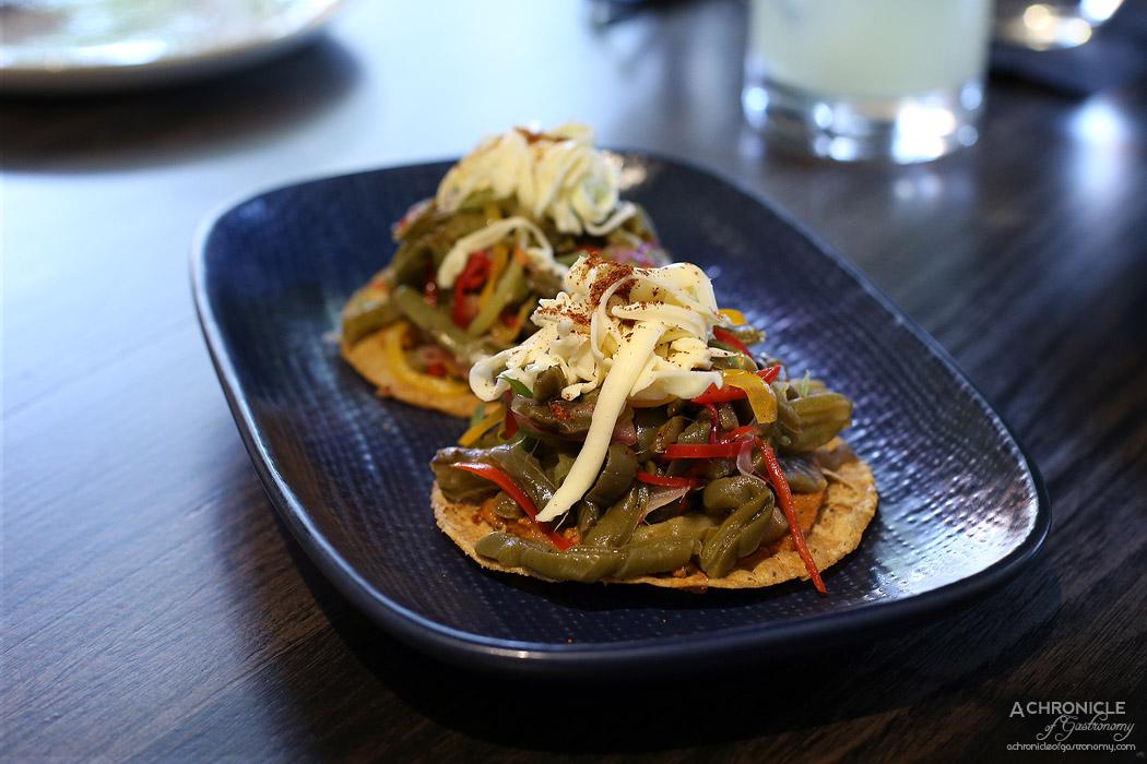 Queen of the South - Nopales Tostada - Cactus salad, peanut de arbol salsa, vegan queso & chilli pequin ($7)