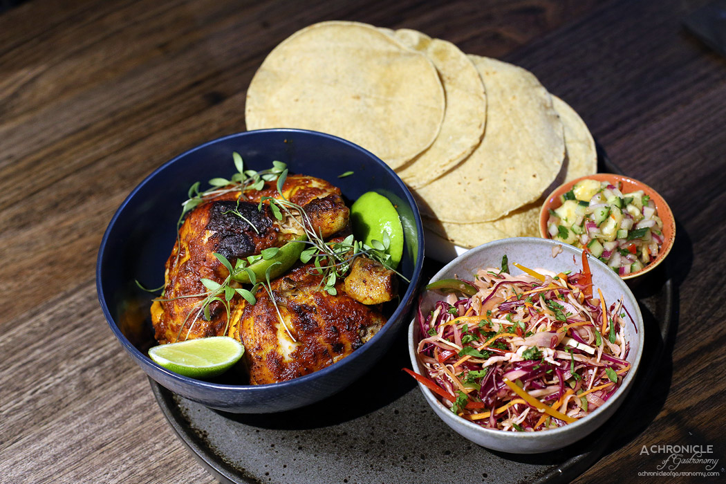 Queen of the South - Pollo Pibil - Achiote marinated chicken with pineapple lime salsa & micro slaw ($34)