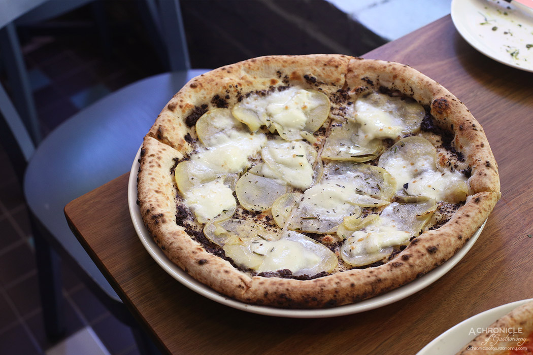 SPQR - Tartufo - Truffle paste, potato, rosemary, mozzarella di buffula ($22)