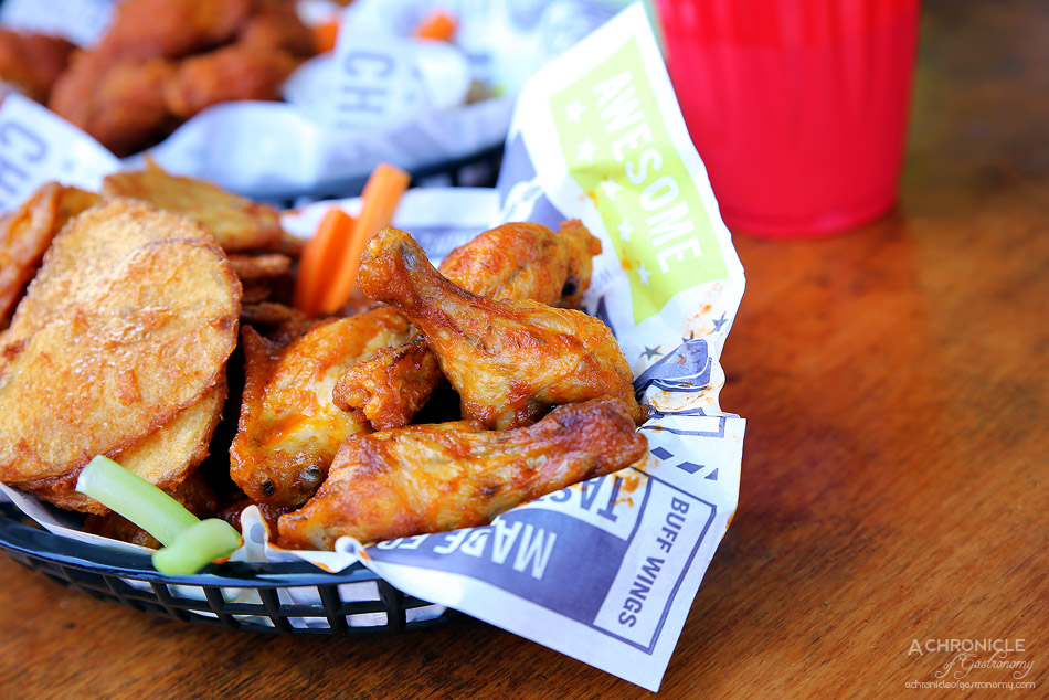 Wings of Glory - Ten piece original wings w Cajun Cho, hand-cut chips ($16.90)