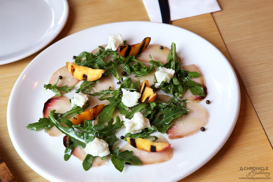 Woodfire Pizzeria - Swordfish carpaccio - Thinly sliced swordfish cured and aged in house for 3 weeks, served w charred nectarines, burrata, rocket and green peppers ($15.90)