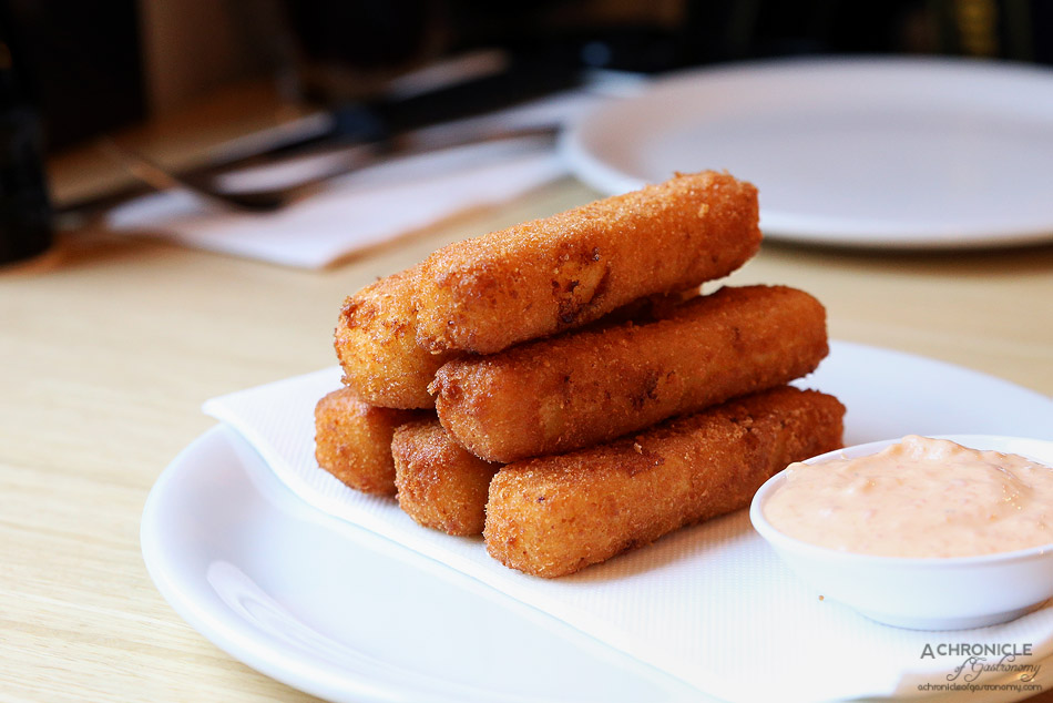 Woodfire Pizzeria - Semolina chips - deep fried cheese filled semolina chips served w spicy aioli ($8)