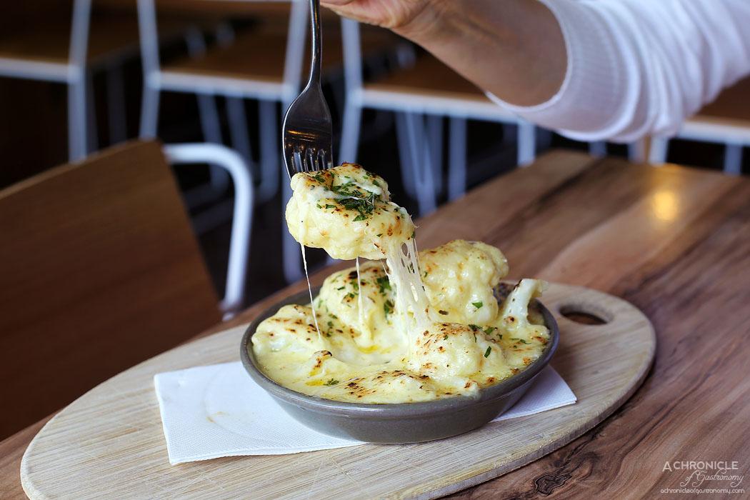 Platform 3 - Baked cauliflower w cheesy garlic sauce topped w toasted almond flakes ($10)