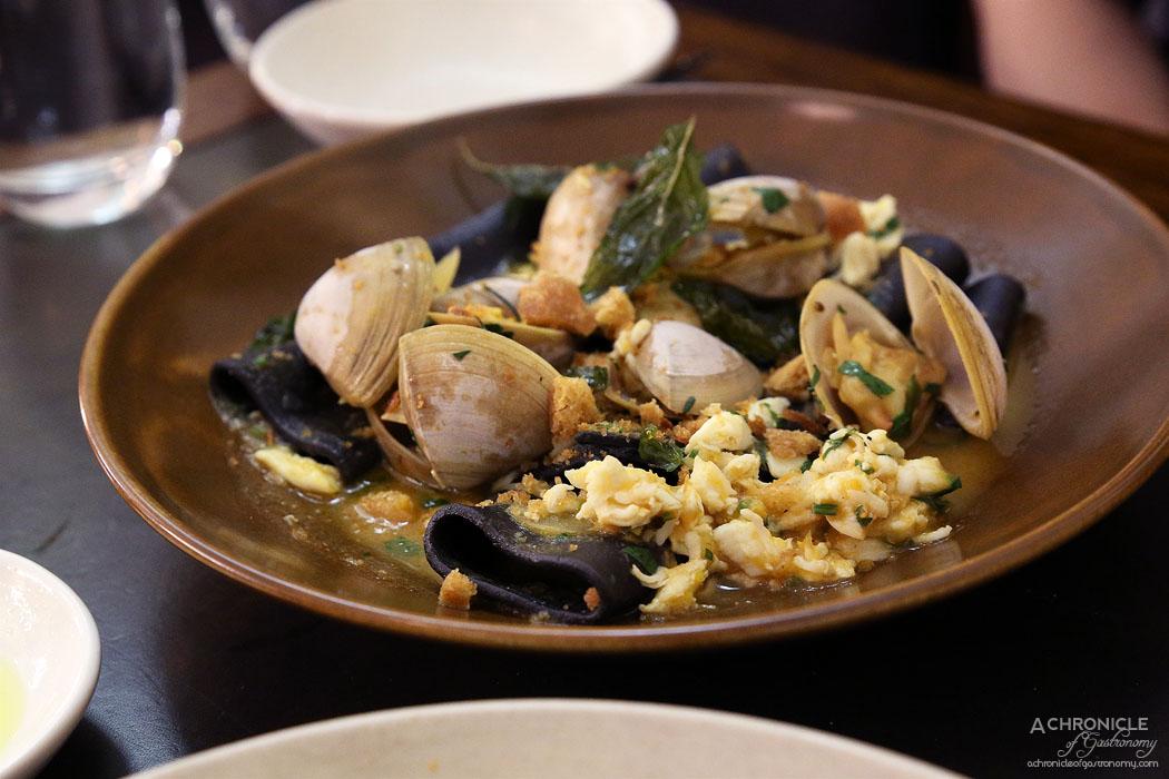 Massi - Squid Ink Paccheri, blue swimmer crab meat, clams, acqua pazza ($26)