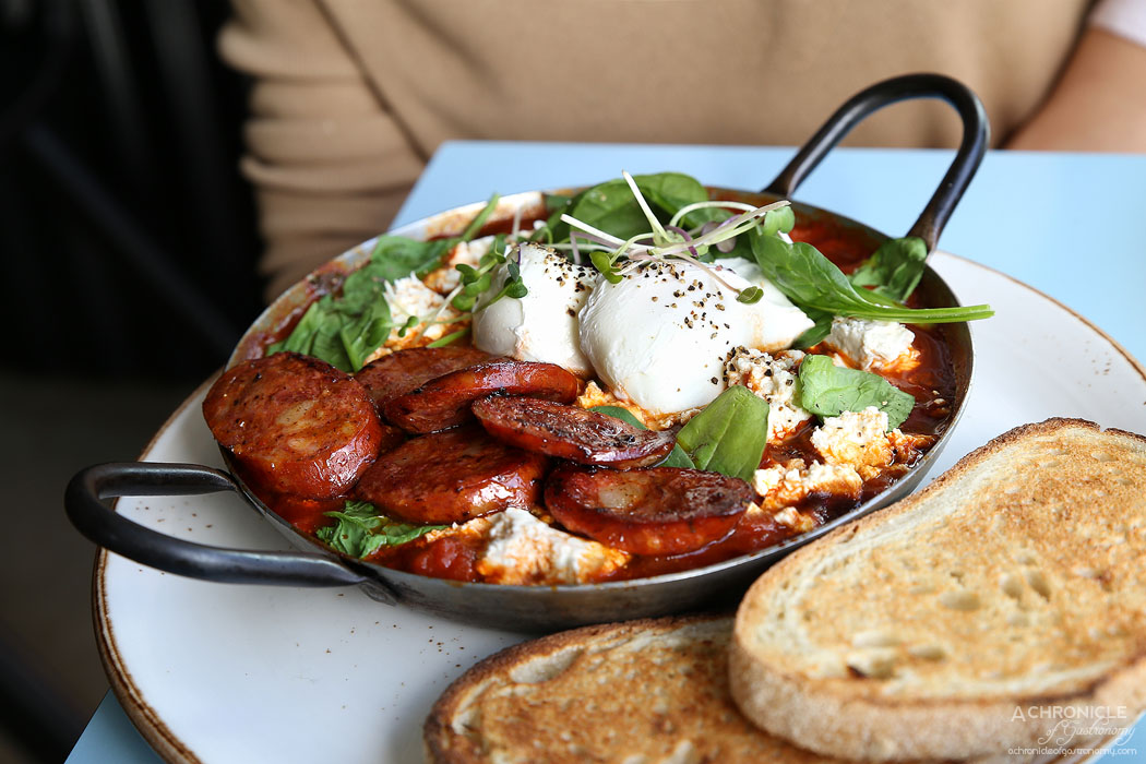 Neon Tiger - Shakshouka w poached eggs, spicy tomato sauce, spinach, peppers, fresh chilli, basil and feta, toast + chorizo ($16+4.30)